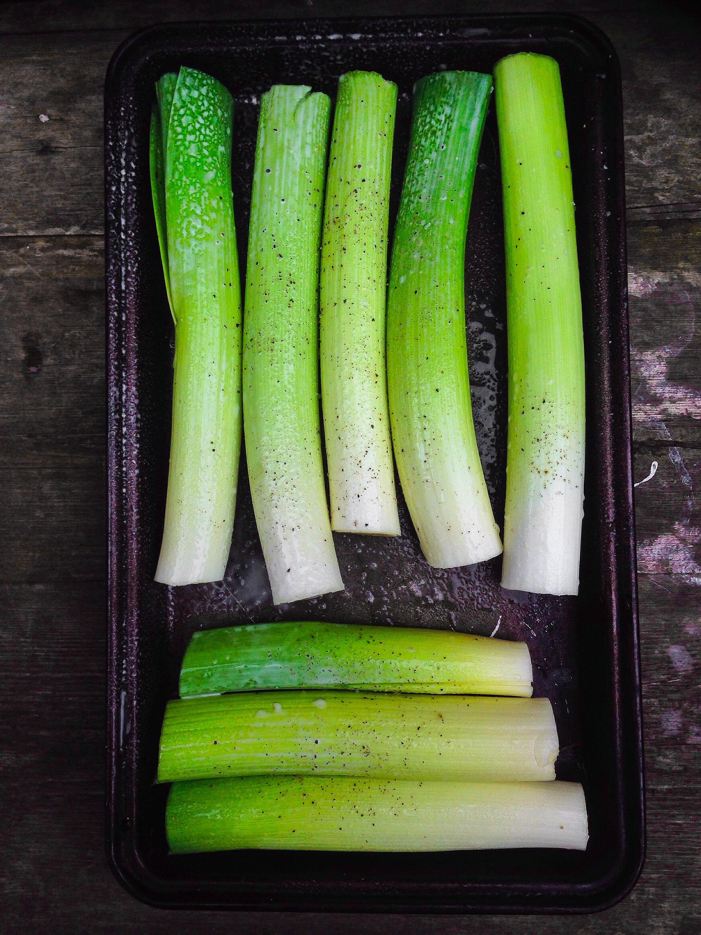 trim your leeks to fit your roasting tin