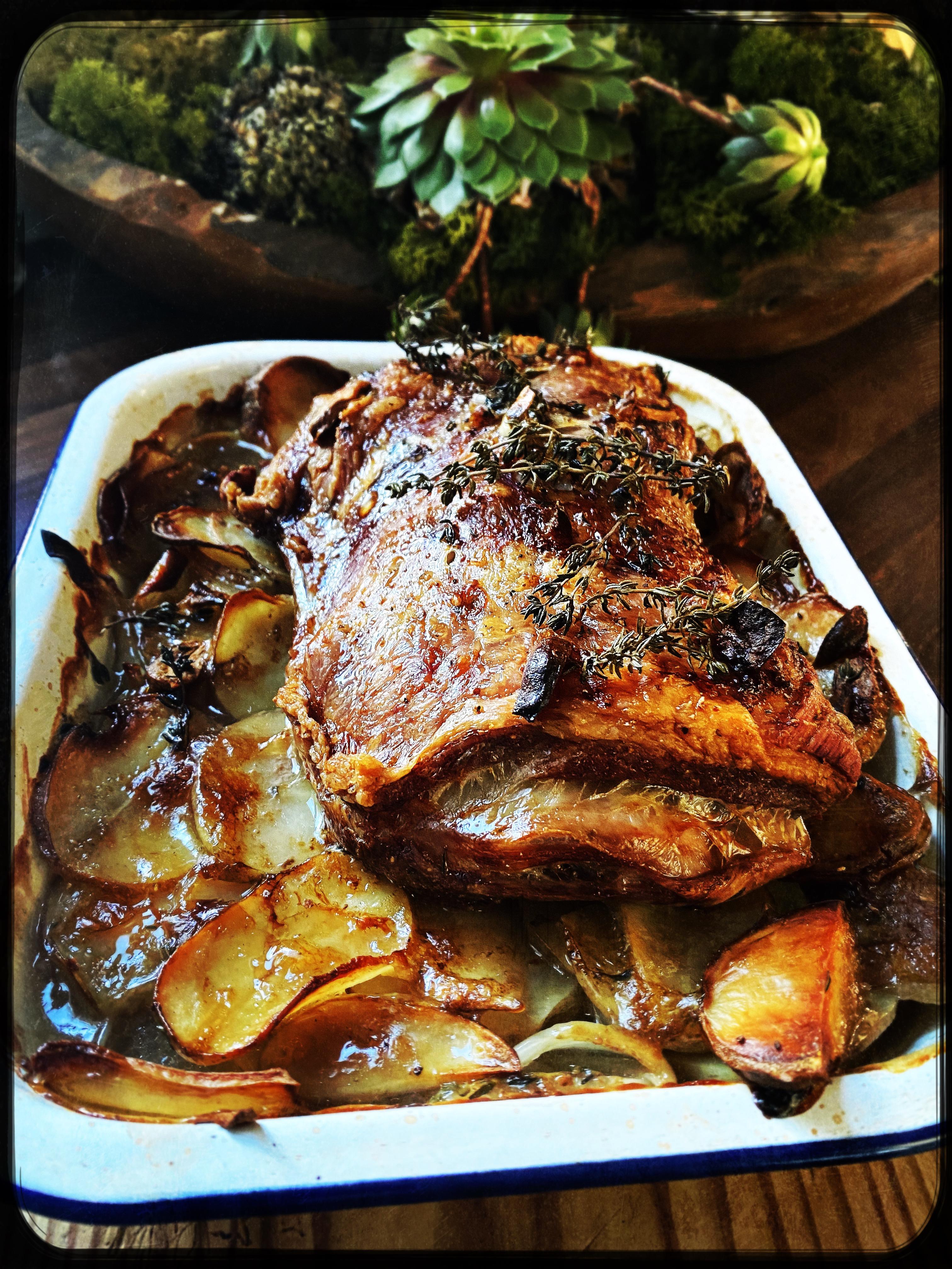 Slow roast lamb shoulder on Boulangère potatoes