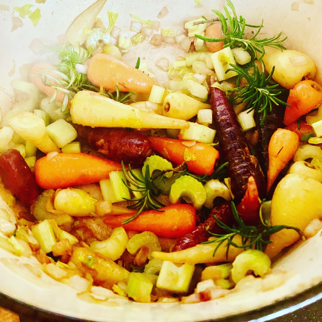 image of veg in the pot being cooked with herbs